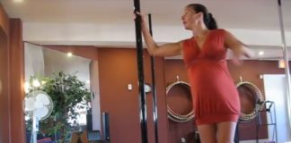 Pole dancing pregnant woman